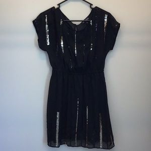 Black flowy dress with gold sequins